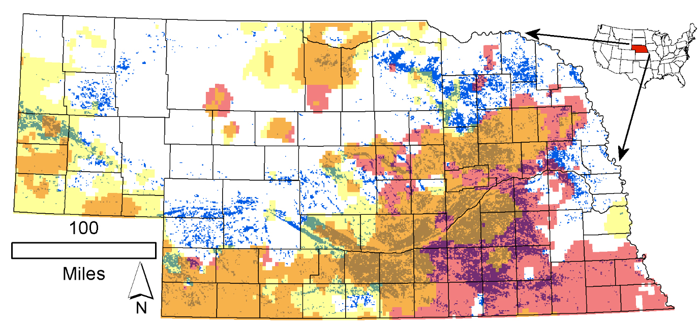Distribution of the 1-square-kilometer cells where irrigated land in 2012 exceeded 50 percent of the cell area (blue-green dots) in Nebraska. Pink corresponds to declining annual, while yellow corresponds to declining irrigation-season precipitation rates