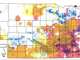 Distribution of the 1-square-kilometer cells where irrigated land in 2012 exceeded 50 percent of the cell area (blue-green dots) in Nebraska. Pink corresponds to declining annual, while yellow corresponds to declining irrigation-season (May-July) precipit