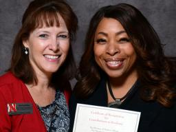Kelli King (right), director of the William H. Thompson Learning Community, accepts her Parents' Recognition Award from Amy Goodburn, senior associate vice chancellor and dean of undergraduate education, during the Parents' Recognition Awards on Feb. 2. M