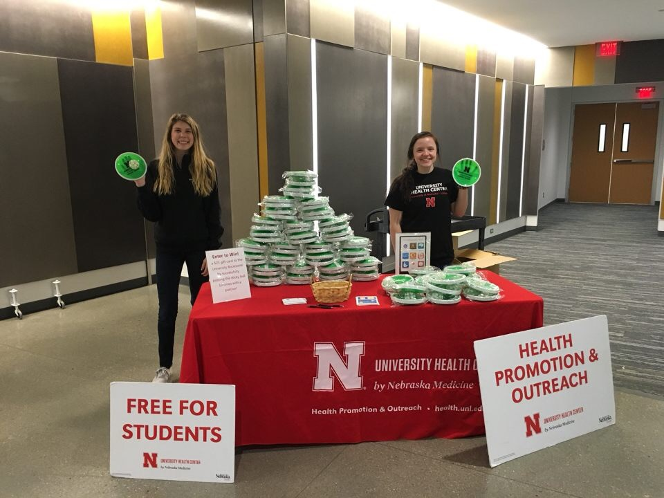Peer educators give away free stuff every week at Husker Health Hub.