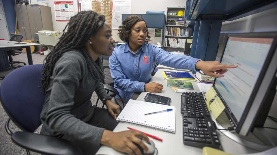 Nebraska's Terri Norton (right) works on a project with Lucy Ampaw Asiedu, a graduate student in architectural engineering. Troy Fedderson | University Communication