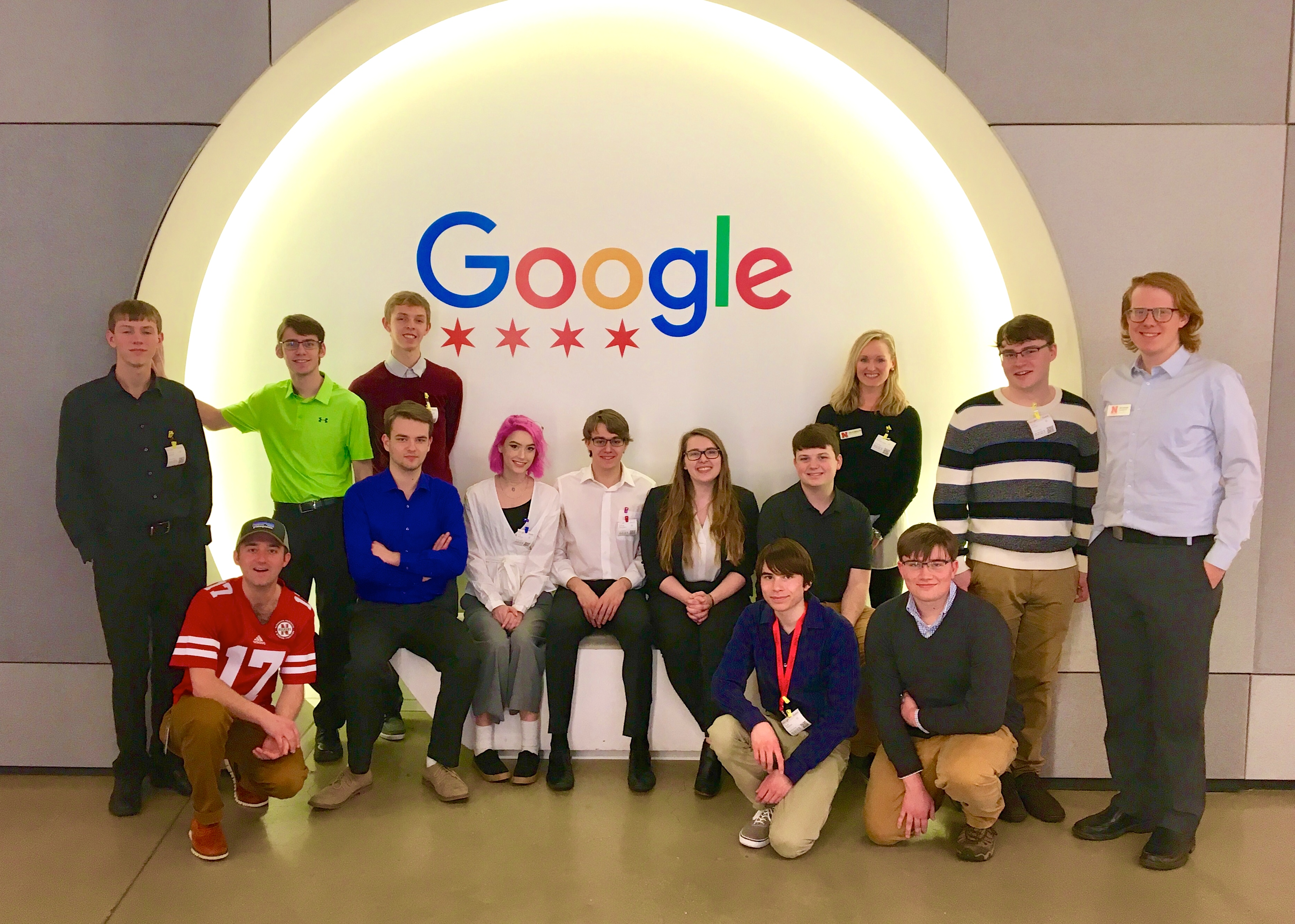 CSE Learning Community students, Recruitment and Retention Coordinator Jenna Huttenmaier, and alumnus Matt Bergh pose together at Google in Chicago.