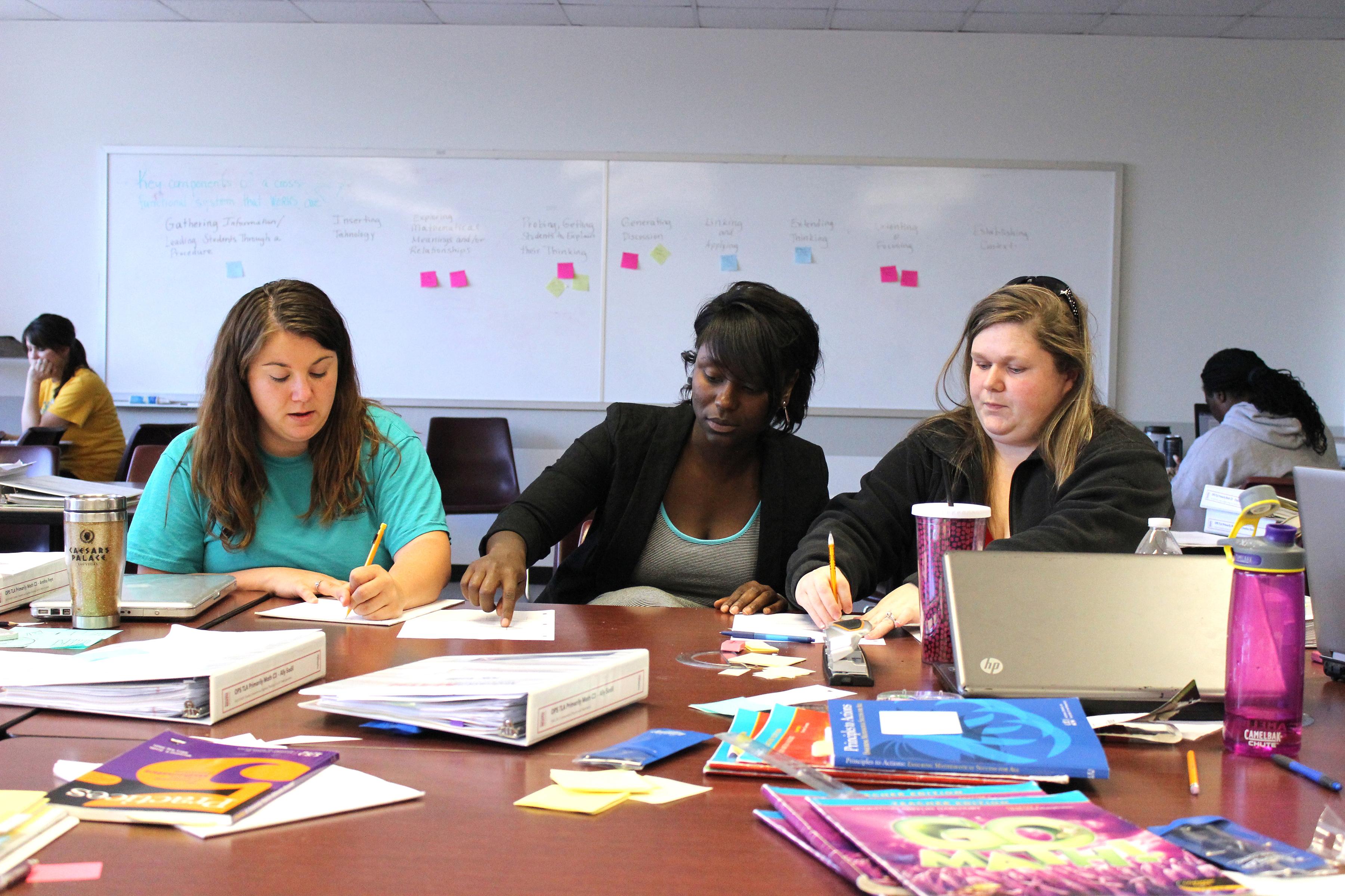Noyce Master Teaching Fellow Kesha King (center), an elementary teacher, co-teaches Primarily Math.