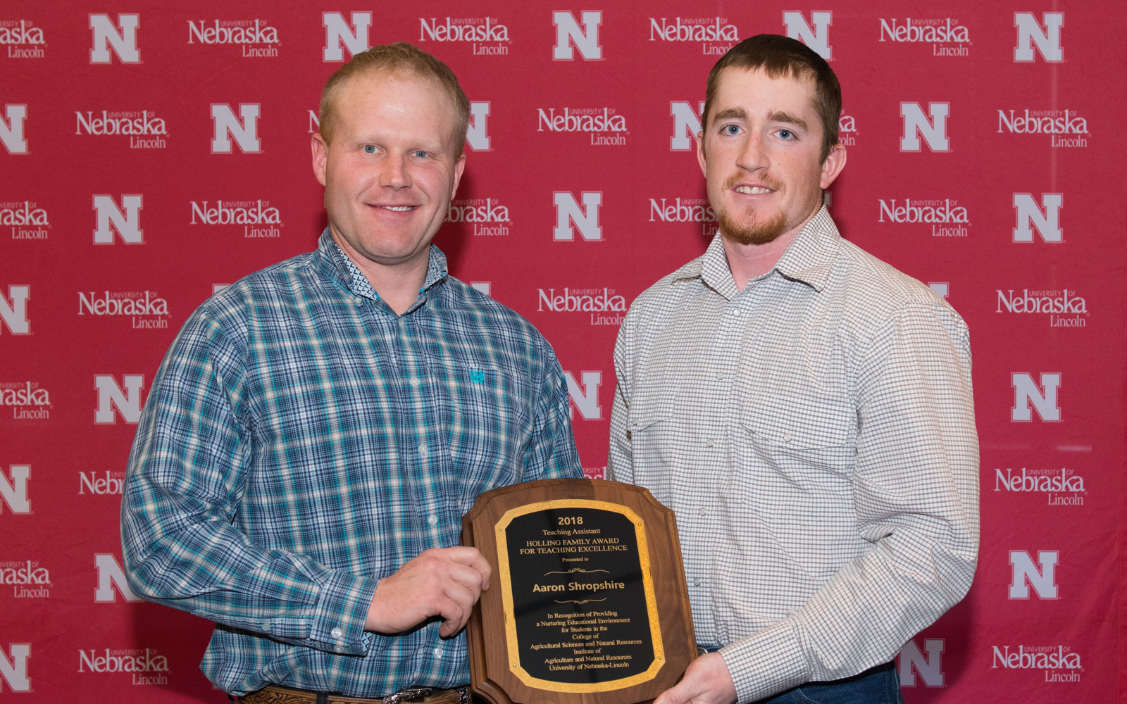 Aaron Shropshire, left, accepts his Teaching Assistant Teaching Excellence Award from Austin Holliday, senior Grazing Livestock Systems major.