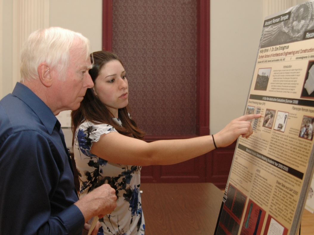 Holly Brink, a junior architectural engineering major, discusses her undergraduate research project on an ancient Roman temple reconstruction project with Keith Sawyers, professor emeritus of architecture, during the 2010 Research Fair.