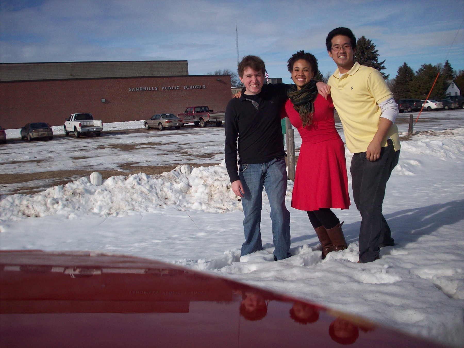 The Ezinma Trio outside Sandhills Public Schools in January. Pictured (from left) is Michael Glur-Zoucha, Meredith Ramsay and Timothy Paek.