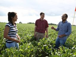 University of Nebraska–Lincoln student researchers Bella Possignolo (left) and Sandeep Bhatti (right) conduct fieldwork with DWFI Faculty Fellow and Nebraska irrigation engineer Derek Heeren.