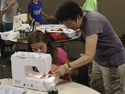 A 4-H sewing help session in 2017.