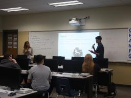 Jasmine Boyer and Jake Petersen presenting at Schoo Middle School last week.