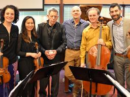 """Philip Glass (third from left) with the Chiara String Quartet and Paul Barnes at a rehearsal for """"Annunciation"""" on April 16. Photo by Michael Reinmiller."""
