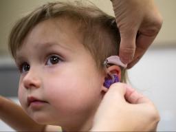 Evie Rausch is one of the 390 children who has received hearing aids through HearU Nebraska.