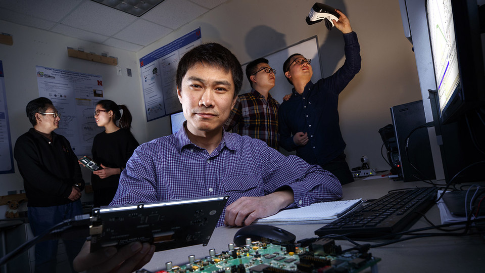 Sheng Wei (center), assistant professor of computer science and engineering at Nebraska, has earned a Faculty Early Career Development Program award from the National Science Foundation to advance his work in computer hardware security and trust. Behind W