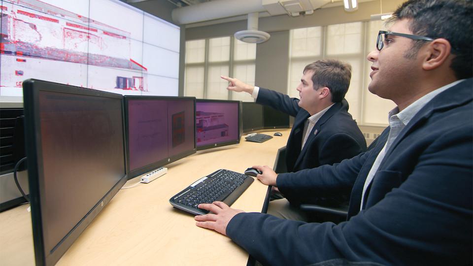 Dr. Richard Wood and Ebrahim Mohammadi analyze structural data