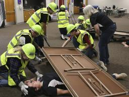 During light search and rescue training, Extension Associate  Soni Cochran explains how to safely use cribbing to help lift objects off victims trapped under debris.
