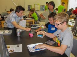 Chuyang Liu (left) and Dr. Yusong Li (right) teaching middle school students about Nano Sand.