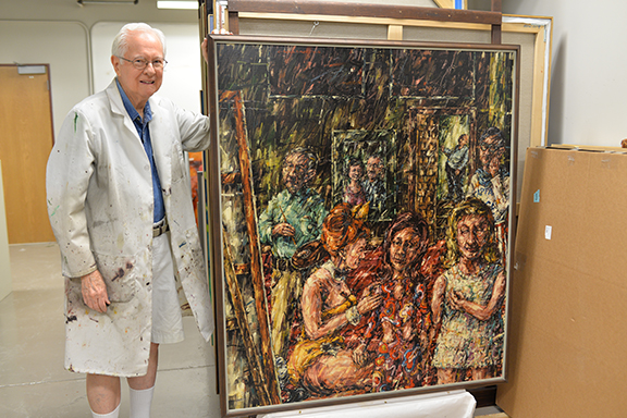 """Dan Howard with his 1967 painting, """"Maids of Honor,"""" which will be his earliest work featured in the exhibition """"Past and Present: A Celebration of Painting at UNL."""""""