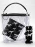 """Fenced Dogs"" features transparency with vinyl and hex mesh to achieve a whimsical bag and accessories featuring a dog print wristlet with dog collar strap. Photo by Bob Meier."