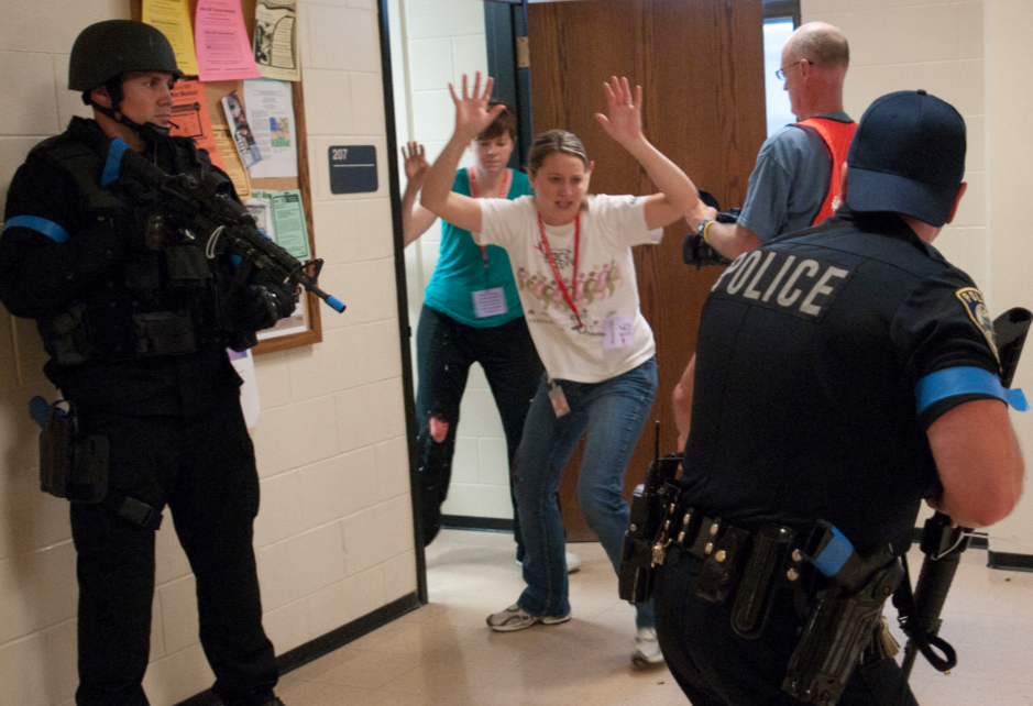 Incident volunteers run from a classroom as police clear Oldfather Hall during the TERREX11 simulation at UNL. Greg Nathan/University Communications