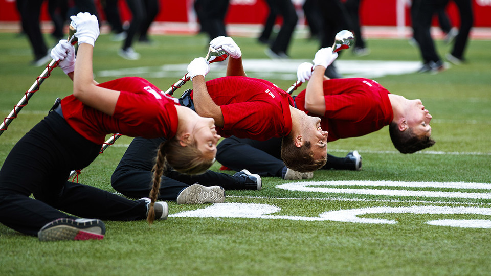 The drum majors take a bow before the Cornhusker Marching Band exhibition Aug. 17 at Memorial Stadium. | Craig Chandler | University Communication