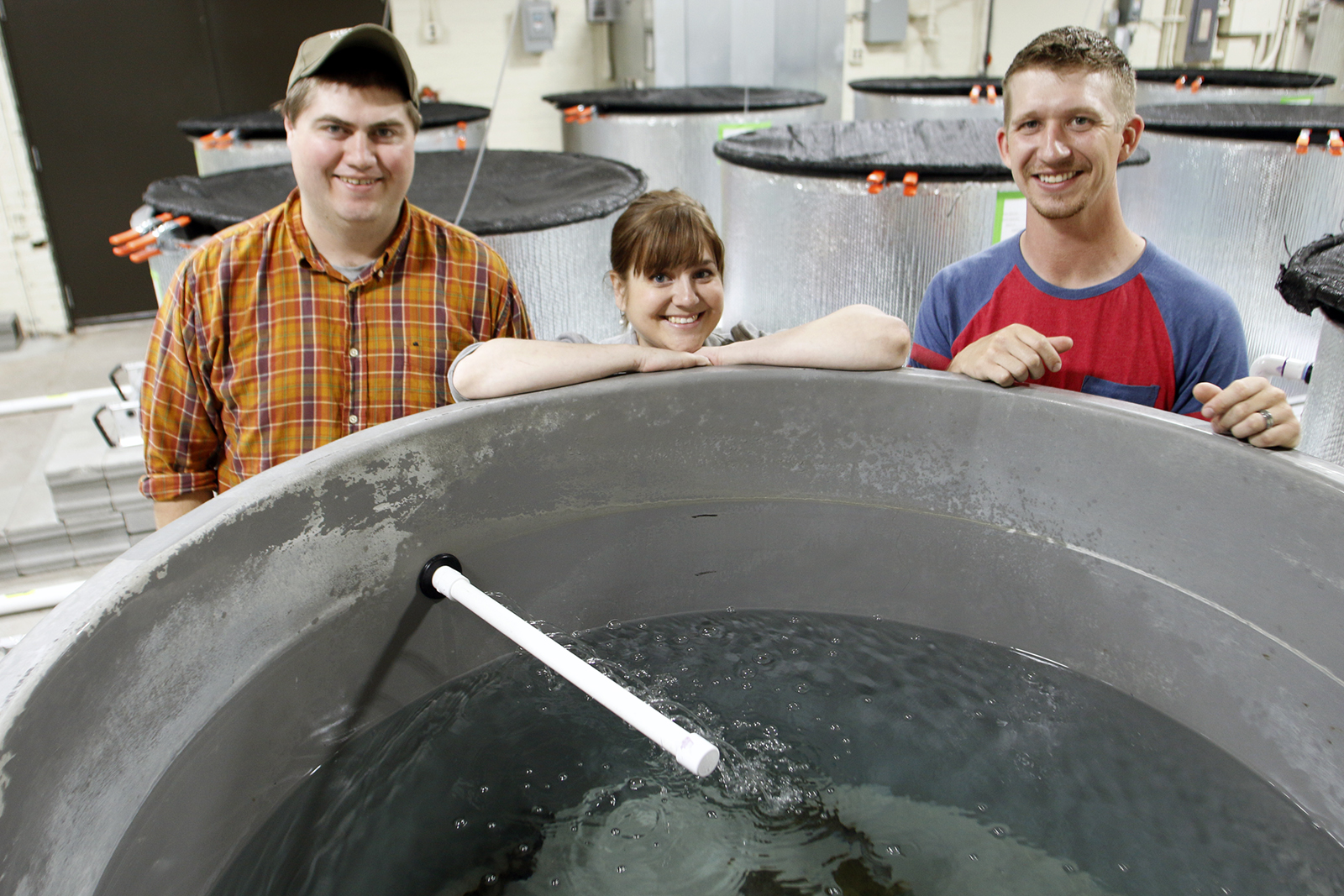 Jamilynn Poletto, fish physiologist with the School of Natural Resources, transformed an old East Campus building into a cutting-edge fish research laboratory space. With her here are Alex Engel (left) and Zach Horstman, both graduate students at SNR. | S