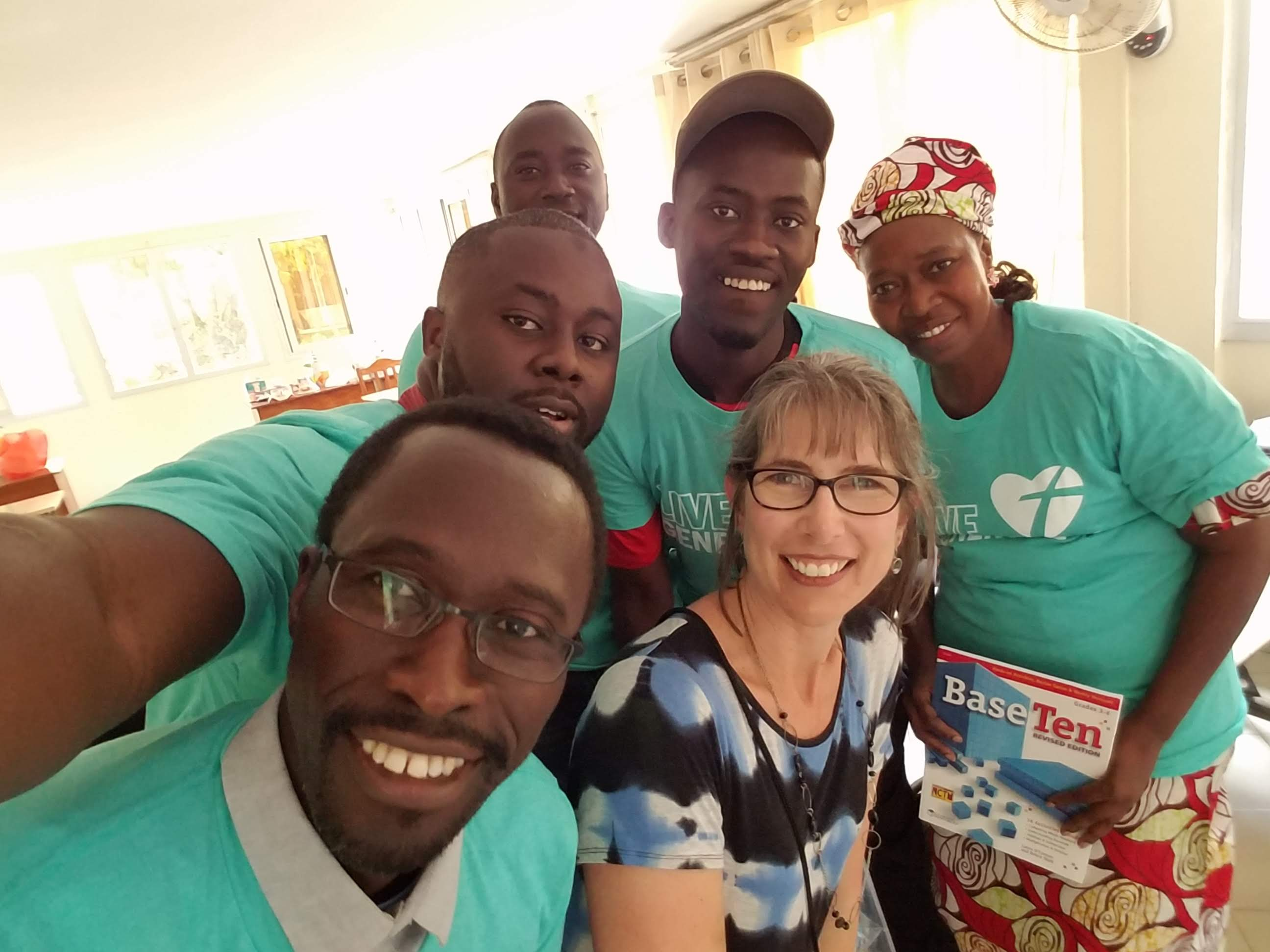 Dr. Michelle Homp at 2018 Afrimath Summer Program. Sharing Base-10 blocks (and t-shirts) provided by a Thrivent Action Grant.