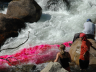 Students conduct a dye tracer test in the Popo Agie River near Lander, Wyoming to determine stream discharge and travel time. Courtesy School of Natural Resources.